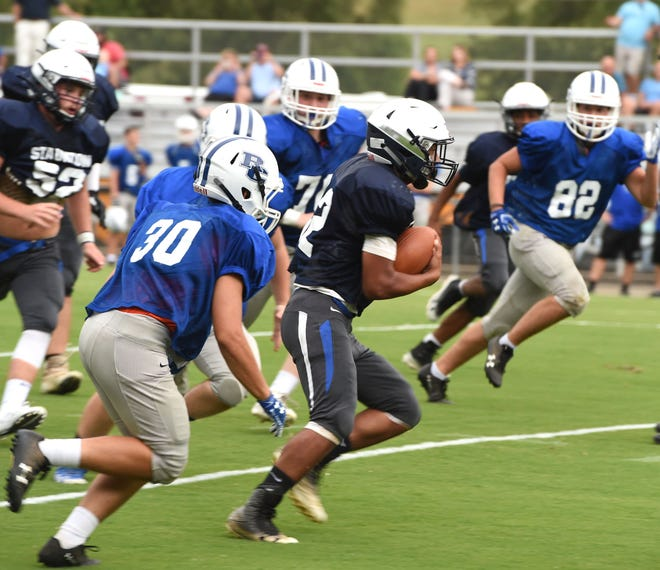 Staunton's Tristan Chaplin carries the ball Friday, August 23, during the Storm's scrimmage at Wine Stadium.
