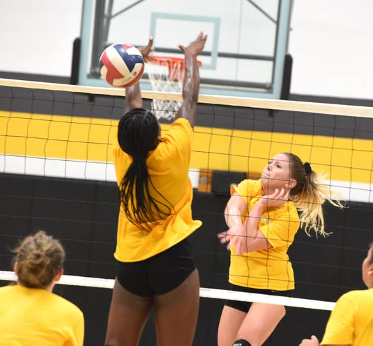 Mary Baldwin junior Deborah Black with the attack during a practice Monday night.