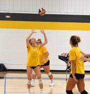 Emma Tomlinson (setting) and Olivia Modlin (behind Tomlinson) both graduated from Riverheads last spring. Both are now part of the Mary Baldwin volleyball team.