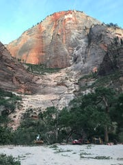 Work crews arrive to dig through the debris left by a major rockfall at Zion National Park on Saturday, Aug. 24, 2019. The rockfall started from a spot about 3,000 feet above the canyon floor and injured three hikers, according to park officials.