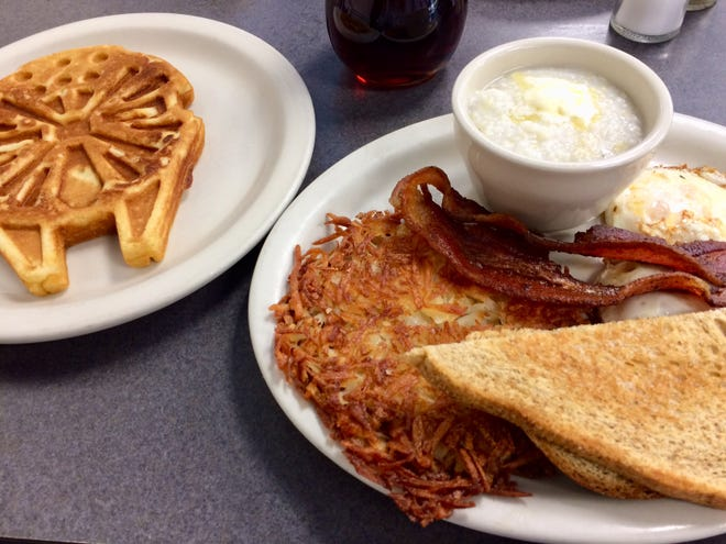 The Lofty Wake-Up Call, a waffle imprinted with a Star Wars Millennium Falcon, two eggs, two slices of bacon, grits, hash browns and toast.