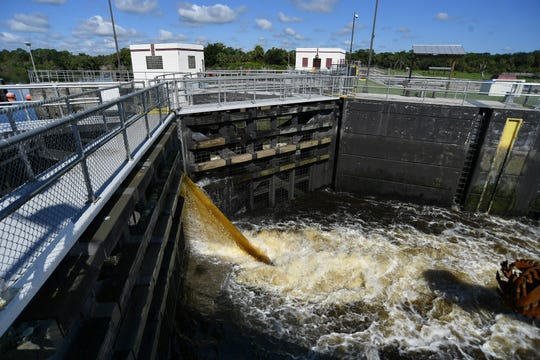 Brown water coming from the Lake Okeechobee side of the St. Lucie Canal (C-44) fills the boat lock for two west-bound vessels on Tuesday, Aug. 27, 2019, at the St. Lucie Lock & Dam, operated by the U.S. Army Corps of Engineers, in Martin County.