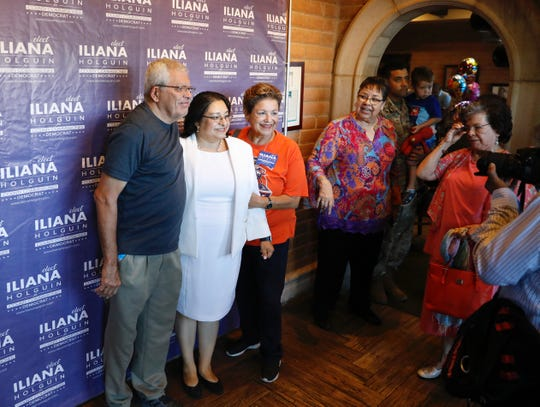 Iliana Holguin, center left, current chair of the El Paso County Democratic Party, announces her candidacy for county commissioner Precinct 3 on Monday, Aug. 26, 2019, at Julio's Cafe Corona.