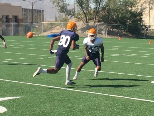 UTEP cornerback Ykili Ross defends a pass against receiver Camryn Curtis Dozier during Tuesday's practice at Glory Field