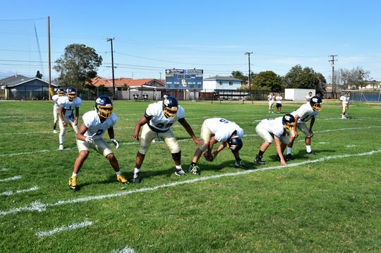Players run a play during a recent Santa Clara High football practice. The school has switched from 11-man to 8-man football for this season.