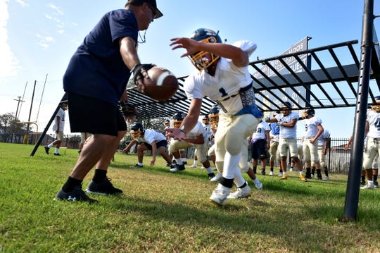 Santa Clara High's Eddie Bicuna runs a drill during a recent practice. Santa Clara has moved from 11-man to 8-man football.