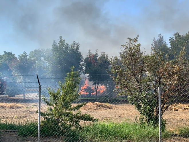 A north county mobile home went up in flames and threatened several homes in the area.