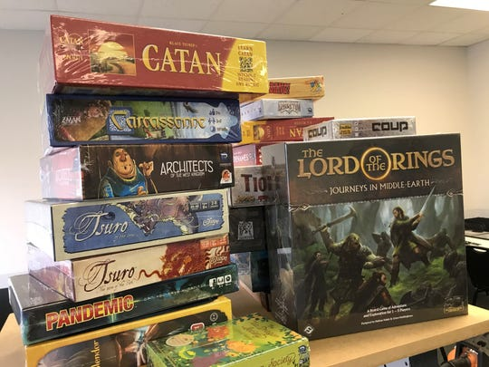 Various board games for sale, and play, at Odin Games and Hobby in Schofield. The store opens Friday, Aug. 30, 2019.