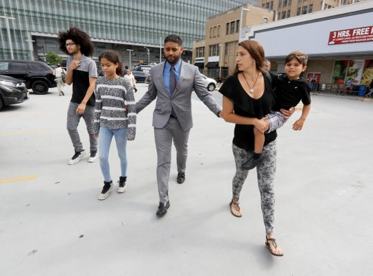 Juan Rodriguez of New City walks with his family from the Bronx Hall of Justice after a court hearing Aug. 27, 2019. With him was his wife, Marissa, daughter Jenna, 12, son Jayden, 16, and son Tristan, 4. Rodriguez was making a court appearance in connection with the July hot car deaths of his nearly one-year old twins.