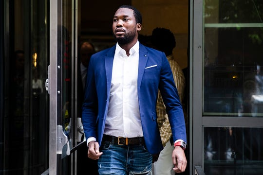 FILE - In this Aug. 6, 2019 file photo, Rapper Meek Mill departs from the criminal justice center in Philadelphia after a status hearing.  Mill is due in court Tuesday to learn if Philadelphia prosecutors will drop a 2007 case that's kept him under court supervision for more than a decade. (AP Photo/Matt Rourke, File)