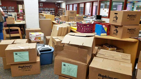 Unpacked boxes sit in the Bayard School's library. The boxes have since been unpacked or moved.
