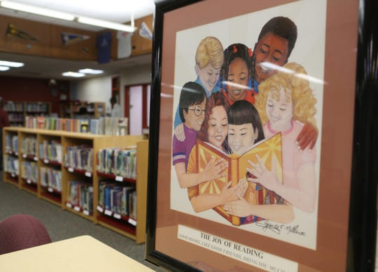 A picture hangs in the library at the Bayard School in Wilmington to encourage reading.