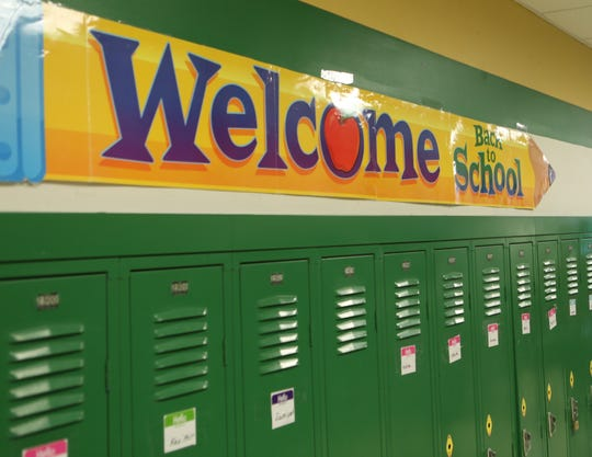A sign in one of the hallways at the Bayard School in Wilmington welcomes students back to classes.