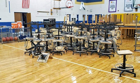 During the move, Bayard's gymnasium was used as a holding area for any supplies and furniture teachers didn't need. The gym was cleared out last week and floor repairs will begin this week.