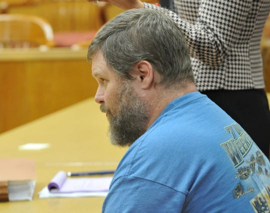 Jason Wayne Carlile sits in the 78th District Court while his attorney talks about the possibility of postponing his  trial in a hearing Tuesday afternoon.