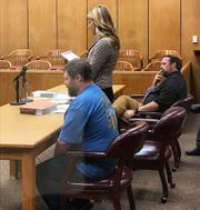 Jason Wayne Carlile, left, listens while defense lawyer Katherine Devlin argues a point during a hearing Tuesday in which she asked Fudge to postpone Carlile's trial. Wichita County Assistant District Attorney Dobie Kosub, far right, waits his turn to argue before Judge Barney Fudge in the 78th District Courtroom.