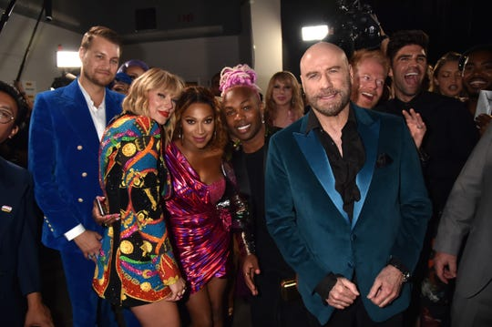 Taylor Swift, Todrick Hall, John Travolta, and Jesse Tyler Ferguson -- with Jade Jolie in the background -- posing backstage.