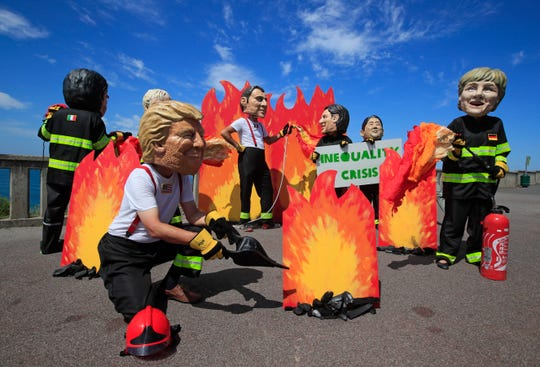 Protesters dressed as world leaders on Aug. 23, 2019, in Biarritz, France, during the summit of the Group of Seven major industrial nations.