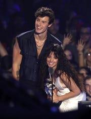 "Shawn Mendes and Camila Cabello accept the award for best collaboration for ""Senorita"" at the MTV Video Music Awards."