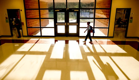 A student walks to class on Aug. 27, 2018, in Houston, Texas.