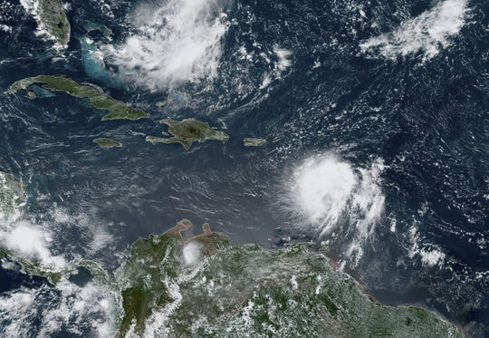 This satellite image obtained from NOAA/NESDIS/STAR GOES-East, shows Tropical Storm Dorian (in the lower part of the image) off South America as it approaches the Caribbean at 17:20Z on Aug.27, 2019. Tropical Storm Dorian intensified August 26, 2019 as it approached the Caribbean on a track that will take it near Puerto Rico and the Dominican Republic by midweek, possibly at hurricane strength, US forecasters said. Although the storm was moving toward Cuba and Florida, forecasters said it could lose strength as it passes over mountainous terrain on Hispaniola, the Caribbean island shared by Haiti and the Dominican Republic.