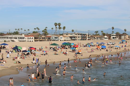 Wide, sandy beaches welcome rows of sunbathers in Seal Beach.