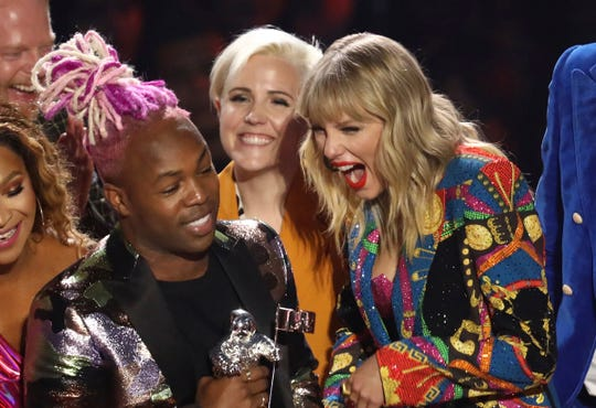 """Taylor Swift, right, accepts the video for good award for """"You Need to Calm Down"""" at the MTV Video Music Awards at the Prudential Center on Monday, Aug. 26, 2019, in Newark, N.J. (Photo by Matt Sayles/Invision/AP) ORG XMIT: NJDC311"""
