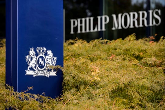 A company sign is seen outside the international headquarters of the US tobacco company Philip Morris, in Lausanne, Switzerland.