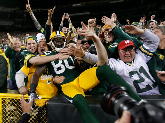 "Donald Driver celebrates a touchdown during the 2012 season with a ""Lambeau Leap."""