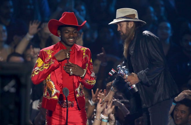 "Lil Nas X, left, and Billy Ray Cyrus accept the song of the year award for ""Old Town Road"" at the MTV Video Music Awards."