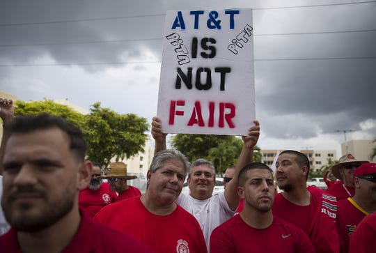 Union workers picket near the entrance to an AT&T facility as the Communications Workers of America strike against the company alleging AT&T management engaged in unfair labor practices during contract negotiations on August 26, 2019 in Miami, Florida.