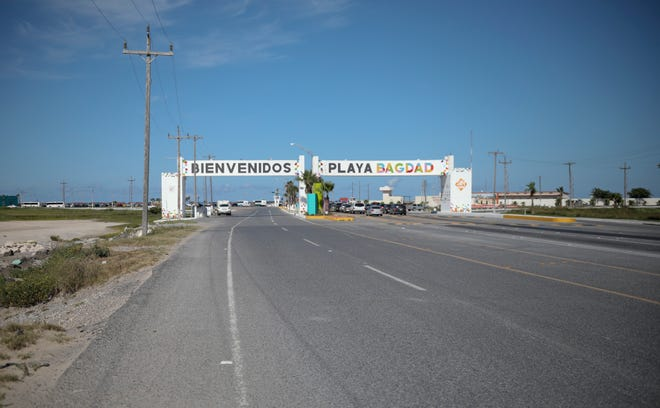 This Aug. 3, 2019 photo shows an entrance welcoming travelers to Playa Bagdad near the border city of Matamoros, Mexico. DEA Special Agent Sammy Parks said Playa Bagdad is a center for loading and unloading drugs bound for the U.S. market. It is a short, easy route without much law enforcement.