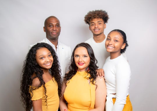 Aisha Ceballos-Crump, center, is the founder/CEO of Honey Baby Naturals. Her family is husband Greg Crump, rear left; son Khalil, rear right; Kyra and Karynn.