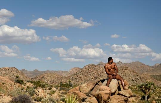 Myles Garrett poses atop rocks at Joshua Tree.