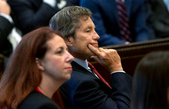 Defense attorney Larry Ottaway, right, listens as Judge Thad Balkman reads a summary of his decision in the opioid trial at the Cleveland County Courthouse in Norman, Okla., Monday, Aug. 26, 2019. Balkman ruled in favor of the state of Oklahoma and ordered Johnson and Johnson to pay $572 million to a plan to abate the opioid crisis.