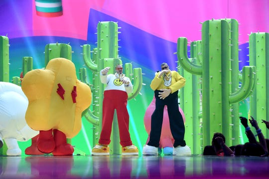 Bad Bunny and J Balvin perform onstage during the 2019 MTV Video Music Awards.