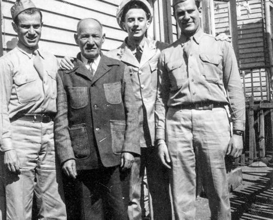 From left, Larry Tisch, Alan Medoff and Bob Tisch in their military uniforms with their grandfather Shlomo Tichinsky just after World War II.