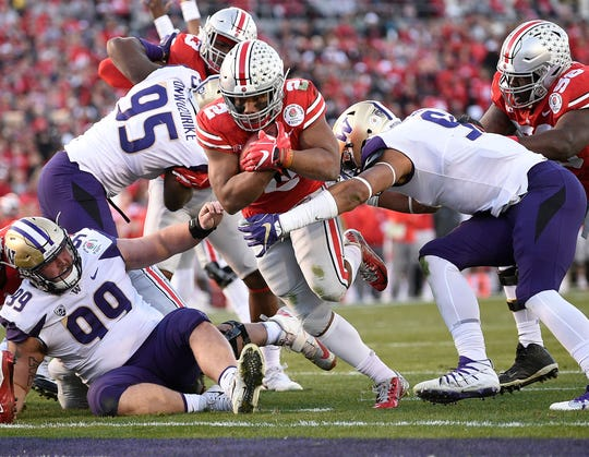 Ohio State running back J.K. Dobbins scores a touchdown against Washington during the 2019 Rose Bowl.