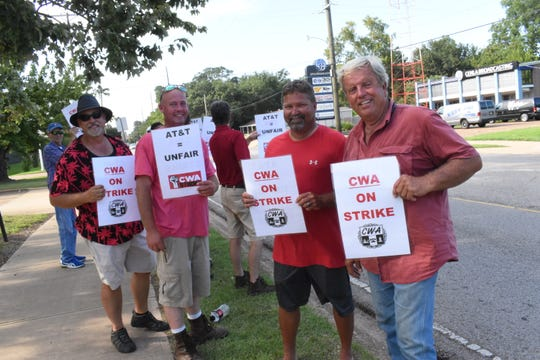 """Mark Bernard (left), Christopher Cross, Troy Ballard and Danny Ivie are among the 75-80 members across Central Louisiana and among the 22,000 across nine states in the Southeast """"walking the line"""" against AT&T. The strike ended Wednesday morning and CWA members were to return to work in the afternoon. Henry Rosenthal, vice president of the Communcations Workers of America Local 34, said the workers are striking against unfair labor practices by AT&T """"because they didn't send the proper representation to negotiate at the bargaining table."""" """"We've actually had different locations set up here locally,"""" said Rosenthal.Ê""""One's over at Singer Road in Tioga. Also 825 Murray Street downtown as well as here on Texas Avenue."""""""