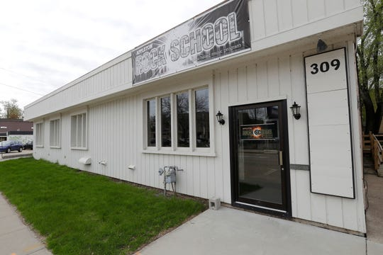 The building housing Appleton Rock School at 309 E. Washington St. in downtown Appleton will be demolished as part of a coming housing development property. The music school's new location in Menasha opens Tuesday.