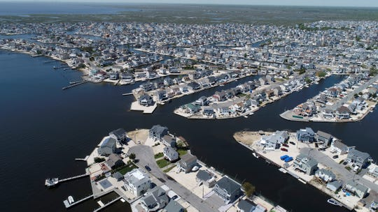 Homes surround lagoons in the Beach Haven West section of Stafford Township Wednesday, May 15, 2019.
