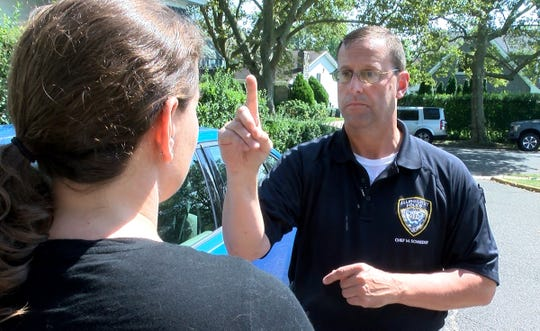 Allenhurst Police Chief Michael Schneider demonstrates the parts of a field sobriety check with Asbury Park Press reporter Susanne Cervenka outside police headquarters Thursday, August 15, 2019.