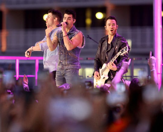The Jonas Brothers perform Sunday night, August 25, 2019, on the boardwalk across Ocean Avenue from the Stone Pony in Asbury Park, NJ.