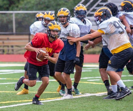 QB Antonio Rosato runs. St. John Vianney held a football practice Wednesday, August 28, 2019, at their school in Holmdel. /Russ DeSantis for the Asbury Park Press