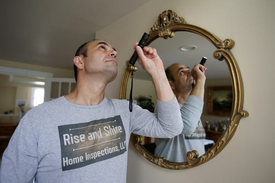 Joseph Napoli, owner of Rise and Shine Home Inspections LLC, a Middletown-based business that performs home inspections, inspects a plumbing problem in his own home in Middletown, NJ Wednesday, August 28, 2019.