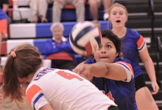 San Angelo Central setter Veronica Guerrero chases down the ball as Caroline Detloff (4) ducks out of the way. Central won the nondistrict match 27-25, 21-25, 25-15, 25-19 on Tuesday, Aug. 27, 2019, at Cougar Gym.