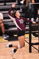 Brownwood's Katelyn Windham (10) goes up for a kill against Abilene High at Eagle Gym on Tuesday. Windham had a match-high 19 kills to go with 17 digs and two aces as The Lady Lions pulled out a five-set victory.