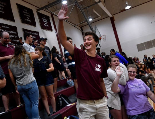 Colin Craft waves to friend during convocation Tuesday at McMurry University. He a junior who hopes to pastor a United Methodist Church congregation.