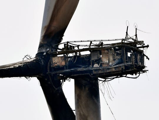 A burned-out wind turbine sits idle above Mulberry Canyon Tuesday. The machine caught fire Monday, sparking Rhodes Ranch 3 Fire.