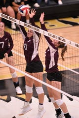 Brownwood's Ashlyn Storm (11) and Olivia Fowler (2) go up for a block against Abilene High at Eagle Gym on Tuesday, Aug. 27, 2019. The Lady Lions pulled out a 23-25, 25-18, 30-28, 22-25, 15-8 victory in the five-set thriller.